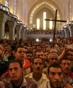 Christians Don't Feel Safe in Egypt, Fleeing to US and Europe to Seek Asylum--Mourners at St. Mark's Coptic Orthodox Cathedral for funeral of four slain Christians.