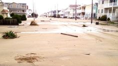 Central Ave. looking south from 52nd Street in Ocean City, New Jersey. Sand covered roads as far as the eye can see.