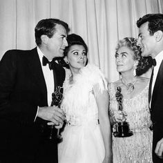 """Gregory Peck, Sophia Loren, Joan Crawford and Fernando Lamas backstage at the Academy Awards on April 8, 1963. Crawford accepted the Best Actress award on behalf of Anne Bancroft for """"The Miracle Worker""""."""
