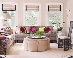 The living room sofas and leather ottoman are by Timothy Whealon, the sofa pillows are covered in linen and vintage suzanis, the vintage table lamp is from Aero, and the floor lamp is by Restoration Hardware; the circular abaca rug was custom made.  Read more: Photos Of Home Decor Ideas- Hamptons Home Photos - ELLE DECOR Follow us: @ELLE DECOR on Twitter | ELLEDECORmag on Facebook Visit us at ELLEDECOR.com