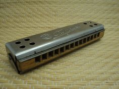 Harmonika from old 70s. Made in Soviet Union Condition is good. Its wooden with metal parts. Name of harmonica - Sputnik  harmonica has light signs
