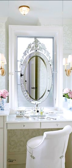 Beautiful Venetian mirror as a vanity mirror over a well arranged white dressing table. Love, love,  love.