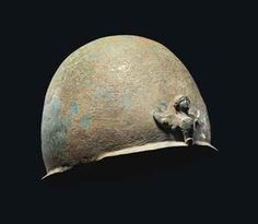 A ROMAN BRONZE HELMET  CIRCA 1ST CENTURY B.C.