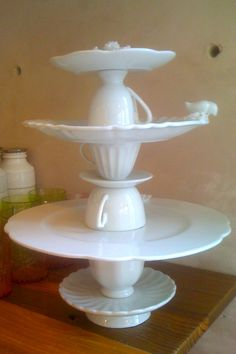 Anthropologie Tea Cup Cake Stand - so need to make this! ~ Lovely and creative idea.