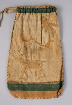 """Ladies linen embroidered drawstring reticule, with green banding at top embroidered with various animal designs including birds, deer, snake and crab. Condition - Good condition with no losses to fabric. Some toning to fabric and staining/grime. 11 3/4"""" H x 6 3/4"""" W. Late 18th or early 19th century."""