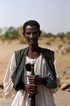 A villager holding a traditional tribal sword in the desert of eastern Sudan, near the border with Eritrea. [Photo: J.B. Russell / MAG, 2011]