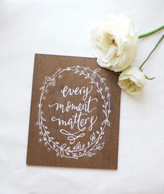 """Small dark stained plywood sign, hand painted """"every moment matters"""" with floral wreath detail. home decor. Rustic Wedding Signs, Rustic Wood Signs, Painted Signs, Hand Painted, Love Wood Sign, Guest Book Sign, Wedding In The Woods, Wedding Table Numbers, Stain Colors"""