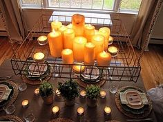 Love this old junk wire basket repurposed as candle chandelier over dining table. (The Painted Home blog)