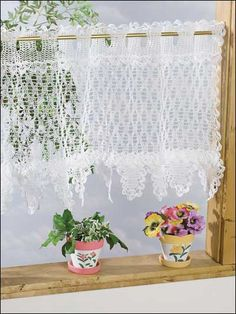 For kitchen windows of an unusual size, consider a DIY project like this and crochet a simple yet functional and attractive window valance...made to fit!