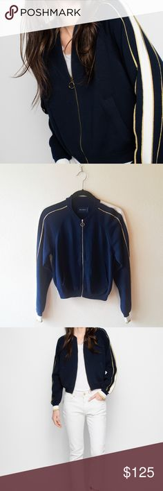 """Zadig & Voltaire Teri Teddy navy bomber jacket, XS Description: - Zadig et Voltaire """"Teri Teddy"""" bomber-style knit track jacket - Navy blue with cream and gold metallic stripes on sleeves and shoulders - Two pockets - Ribbed hem and cuffs - Gold-tone ring pull on zipper - Cotton blend: 95% cotton, 4% polyamide, 1% Metallic fibers - Good pre-owned condition: Small snags in fabric (see last pic) and very light pilling in the armpit region  Approx. Measurements: - Armpit-to-armpit=18""""…"""