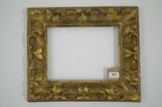 Wooden carved frame and gilt decorated with scrolls. Northern Italy, seventeenth century.