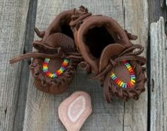 Baby moccasins Chocolate brown infant mossasins beaded in rainbow colors. These moccasins measure 4 inches heel to toe. $34