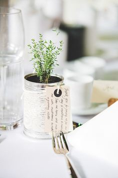Plants in Tin Cans as Wedding Favours with Luggage Tag Thank-you Note   Classic Wedding   Rustic Granary Barns in Woodditton   Navy blue, cream and olive green colour scheme   Artemis Rose bouquet   Image by Jessica Reeve Photography   http://www.rockmywedding.co.uk/alix-ben/
