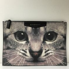 Givenchy cat printed Pochette zip top clutch Brand new with cards and dustbag. Zip top closure. Made in Italy. Givenchy Bags Clutches & Wristlets