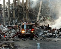A lone fire engine where the World Trade Center collapsed following the Sept. 11 terrorist attack. Surrounding buildings were heavily damaged by the debris and massive force of the falling twin towers.