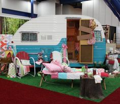 Glamping at the Moda Fabric Booth.  They have a Glamping line of fabric by Mary Jane Butters coming out is spring 2013.  YAY! ...k