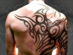 Tribal Back Tattoo (my husband would love this)
