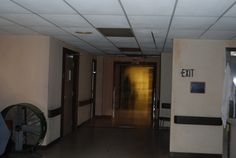 Shadow figures near 2nd floor nurses station. Look close enough & you can make out details.  Both are see through and one cast a shadow on the floor. South Pittsburg Tn. Courtesy of Screaming Eagle Paranormal Society