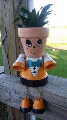 Planter pot person dressed in an orange suit with bow tie Flower Pot Art, Clay Flower Pots, Flower Pot Crafts, Clay Pots, Flower Pot People, Clay Pot People, Clay Pot Projects, Clay Pot Crafts, Painted Plant Pots