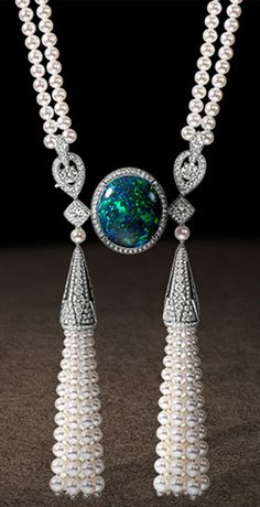 Necklace in platinum, diamonds and cultured pearls, set with a thirty-nine carat cabochon-cut green opal. The necklace is transformable. The bracelets can be attached together to form a long chain. Chaumet, Paris