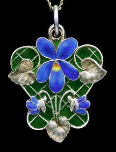 Meyle & Mayer Art Nouveau gilded silver plique-a-jour enamel violet locket.