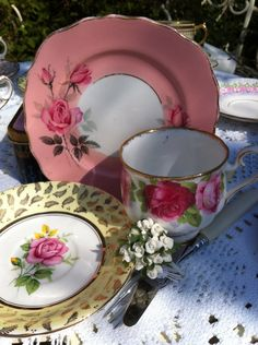 English roses and pinks.  I love the pink border on the saucer.  Beautiful!