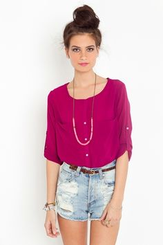 fantastic top and color with high-waisted cutoffs