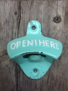Seafoam Green Bottle Opener With White Letters-Cast Iron - Vintage -Retro Kitchen - Man Cave - Metal Wall Decor -Mint Green Pastel - Winter. $8.50, via Etsy.
