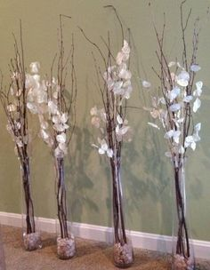 Willow Branch and silver dollar branches in tall glass vases with small stones