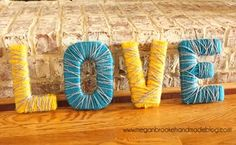 yarn wrapped letters.  A good idea for the babies room or for my classroom.  For the classroom, cover them with maps maybe??