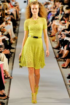 Crocheted Oscar dress in Yellow. Side note - unlike knitting crochet can not be done by machine and therefore any time you see something crocheted it is made by hand. BY HAND....