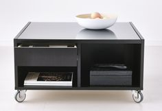 What's worse than no refreshments? Nowhere to put them!  The BOSKEL rolling coffee table from IKEA can double as a serving station right near the action.