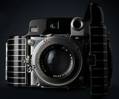 This is the Kodak Bantam Special, a beautiful camera from 1936, made from machined aluminum and finished with enamel...arguably more adventurous in its shape than most modern cameras. And i love it!