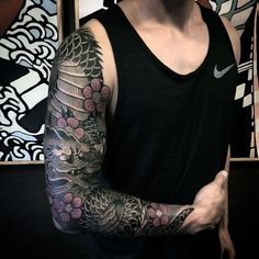Grey Dotted Work Dragon And Pink Flower Tattoo Mens Sleeve