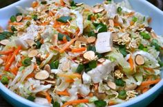 9 Simple ingredients for a delish Chinese Chicken salad       ....  2 Chicken Breasts, cooked,cubed  2 pkgs Cole Slaw Mix (Shredded cabbage, about ten cups)  1 package MatchStick Carrots (about 2 cups)  2 packages Ramen Noodles  1 Cup Sliced Almonds  3 -4 Green Onions, sliced  1/2 Cup Vegetable Oil  1/3 Cup Rice Vinegar  3/4 Cup Sugar