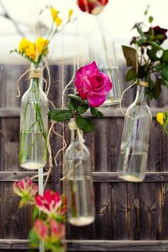 Bottles As Wedding Decor | Intimate Weddings - DIY Wedding Ideas for Small and Intimate Weddings - Remove all the labels and then tie twine around the top of the Bottles and then hang after you put the flower in it . So delicate!