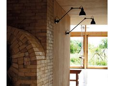 This piece is adjustable for a precisely angled beam and can be used as a wall or ceiling light.