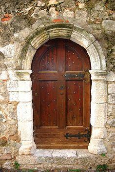 An old door in a Provencal village, Var region, Southern France.