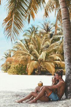 Love & relaxation under a Coconut tree.