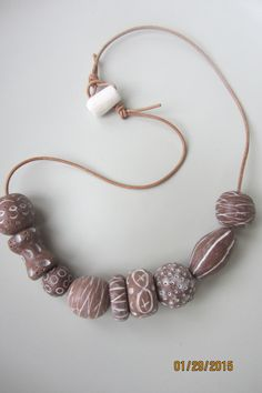 Necklace with rustic looking clay beads in a rich chocolate color. www.etsy.com/shop/casanoni