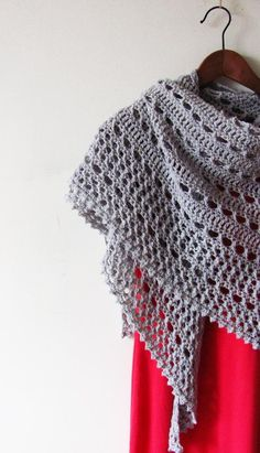 """Northern Sea is a triangular shape shawl crocheted from the top down. It starts from the eyelet rows and ends with a textured knitted-look border made of crossed stitches.Size is easily adjustable by skippingadding more repeats both in eyelet and border sections.Finished size: 69"""" x 30"""" (175 x 75 cm)Pattern both written and charted.Materials needed:• 3 skeins of Anzula Cricket in shade Seaside (DK weight, 80% Merino, 10% Nylon, 10% Cashmere, 229 meters per 114 gr. skein).• 5 mm (H) hook •…"""