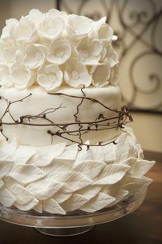 white flower and leaf wedding cake