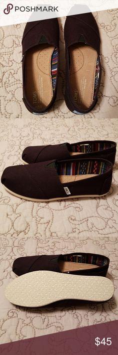 Toms Black Flats NWOT black canvas flats.  Never worn Toms Shoes Flats & Loafers