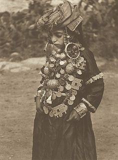 Fantastic collection of Antique Berber Jewels. | Photograph taken by Jean Besancenot (photograph taken approx in 1935) in Tahala, also known as El Ayba Tahalla.