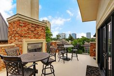 1235 Rue De La Paix Way. Fourth floor rooftop terrace with sweeping views of the city! Also overlooks peaceful protected reserve with park-like setting. Terrace features fireplace with gas logs, stone mantle and beautiful brick surround! Bernstein Realty, Houston Real Estate.