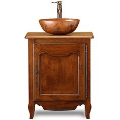 """<ul><li>26""""w x 21""""d x 33""""h (w/o top)</li><li>Native Trails Maestro Oval Vessel in Tempered Copper Finish</li><li>Graff Bali Vessel Faucet in Olive Bronze</li><li>The Lyon custom vanities are available in two Finishes: Medium Cherry (shown) and Dark Walnut</li><li>Top and sink/faucet sold separately</li><li>Made in USA</li></ul><em>*This piece is hand planed and/or hand carved, which can appear as slight distressing.</em>"""
