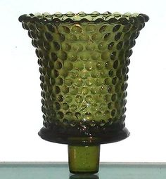 Home Interiors Peg Votive Holder Hobnail Olive Green Vintage  Hobnail pattern like raised dots define the appearance of this pretty holder. This holder is a vintage one, and getting harder to find. Color: Olive Green  Brand: Homco / Home Interiors Height: 3.5 inches, including stem Width: 2.875 inches Color: Clear Material: Glass