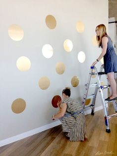 DIY Gold Polka Dot Wall..you could easily replicate this concept by using our vinyl circle decals in gold!