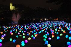 This would be so awesome for a Summer party once it gets dark... or any evening party.  Put baby glow sticks in balloons and place them all over your yard!  LOVE!