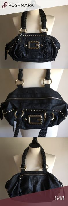Guess Shoulder Bag New with tag. Black faux leather Guess bag with  substantial gold hardware 2aa5a75ec562e